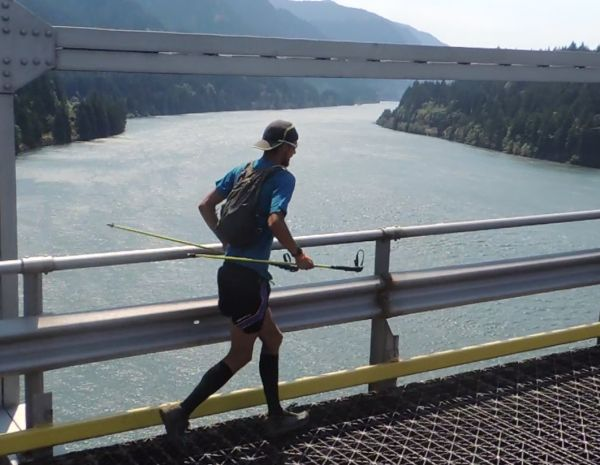 McConaughy crossing the Bridge of the God's on the Pacific Crest Trail